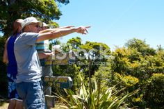 Three men point as they look to the distance by a signpost on Mt. Abel Tasman National Park, A Moment In Time, Types Of Cameras, New Zealand Travel, Turquoise Water, Travel And Tourism, Shutter Speed, Image Now, Dolores Park