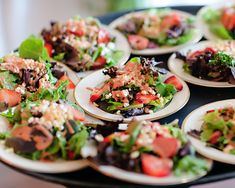 Strawberry salad with goat cheese macadamia nuts and a cilantro lime vinaigrette by  Thomas Caterers
