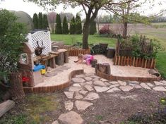 """Sand pit and mudpie kitchen -- How stinkin' cute is that. We didn't have """"stations"""", but I certainly made my share of mudpies. Actually, more like mud spaghetti & dirt bombs. :)"""