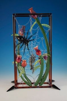 Spider and Flowers by Darby Holm | Community Post: 15 Pieces Of Glass Art That You Wouldn't Believe Are Pipes