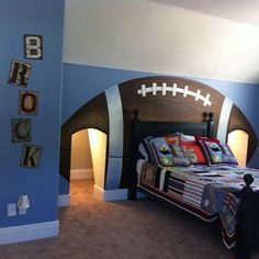 Love this little boys room.... Perfect for my boys we could totally do this too b/c we have the same attic space with the doors!! Too cool!  :)