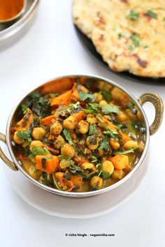 Easy One Pot Chickpea Sweet potato Spinach Curry with Indian  Spices. VeganRicha.com  From Facebook: Used pressure cooker. I used precooked chickpeas, omitted oil, and sauteed all ingredients as per directions through tomatoes.  Then added in sweet potatoes Then added in sweet potatoes and chickpeas and water, brought to pressure for 10 min with natural release, and stirred in spinach and lemon juice. I tripled all ingredients but only used 3 cups water.