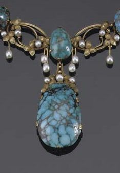 AN ART NOUVEAU TURQUOISE NECKLACE. Composed of openwork foliate links set with small pearls divided by cabochon turquoise sections, circa 1900.