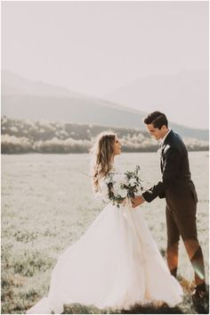wedding   first look   outdoors   landscape   candid   bride and groom   boho   fields
