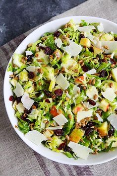 Shaved Brussels Sprouts Salad-Thinly Shaved Brussels Sprouts With Apple, Dried Cranberries, Sunflower Seeds, Parmesan Cheese, And A Simple Maple Mustard Dressing. This Easy Brussels Sprouts Salad Is The Perfect Side Dish For Fall Or The Holidays. #brusselssprouts #sidedish #vegetable #salad #thanksgiving #christmas #holidays #easyrecipe #healthyrecipe #glutenfree #vegetarian
