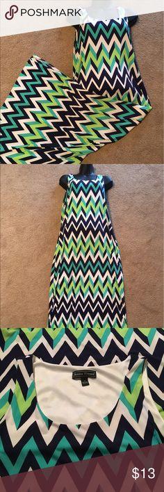 Chevron maxi dress size medium Chevron maxi dress, size medium slits on both sides and lined halfway down. Dresses Maxi