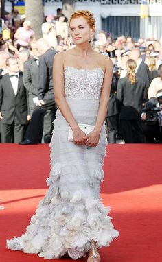 Diane Kruger wearing Chanel Quilted Timeless Clutch and Chanel Spring 2006 Couture White Dress.