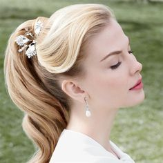 For an updo that's sophisticated but not prim, pull hair back into a high pony and lightly curl the tail and bangs to create a swoop. So '60s! @mira