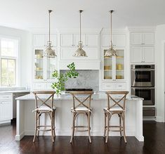 All white kitchen is looking real good! We love how simple and clean this looks! Also the bar stools are the perfect addition. This kitchen is for sure a dream kitchen.