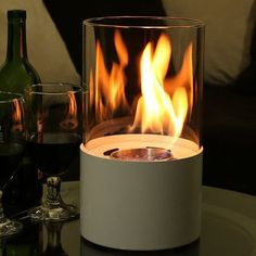 Pick up a miniature ventless ethanol fireplace at Serenity Health, such as the sleek Sunnydaze Fiammata Tabletop Fireplace. Tabletop Fireplaces, Bioethanol Fireplace, Fireplace Glass, Tabletop Patio Heater, Cute Apartment, Apartment Ideas, Home Improvement Tv Show, Modern House Design, Cozy House