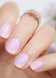 An elegant neutral base of color with colored oblique edge of the nail polish in pink, looks soft and fresh. Hands look neat and tidy. It creates a fragile