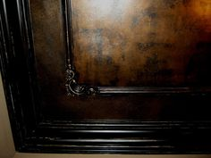 http://distinctiveapplications.com/Bronze-Ceiling-with-Distressed-Black-Woodwork-21.jpg