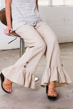 High quality linen pants with a ruffle on the bottom with buttons! Super cute and can be dressed up or dressed down! Inseam measures about 30 in. on a size Small! XOXO Ruffled Linen Pants by Wanna B. Plazzo Pants, Salwar Pants, Linen Pants Women, Pants For Women, Clothes For Women, Fashion Pants, Fashion Outfits, Fashion Trends, Sewing Pants