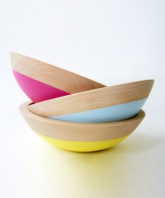 These colorful dipped salad bowls will welcome spring into your dining room. Each is carefully hand dipped in colors mixed specifically for each bowl. The colored portion is a soft rubber which makes it durable and non-slip. The wood is left beautifully natural. Comes in pink, yellow and blue
