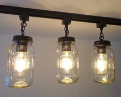 """Use your own track and get a fun & fresh mason jar track lighting update. * Each mason jar 7.5"""" high and 4"""" wide * Hangs 11"""" down from track * 40 watt maximum A15 bulb, Candle style, CFL or LED (not i"""