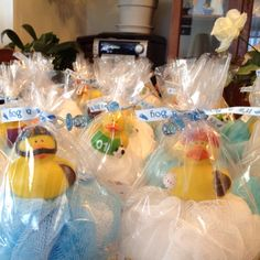 Baby shower favors for a boy. Louffas with sports duckie!  Could add a travel size Bath and Body works shower gel.  SOOOO cute!
