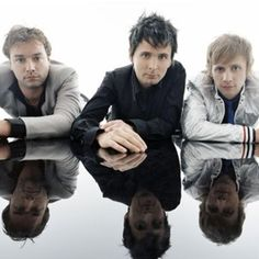 Muse's first band name was Gothic Plague. After Gothic Plague came Fixed Penalty, and after that, Rocket Baby Dolls.[12] In 1994 the band used the name Rocket Baby Dolls[13] with a goth/glam image to compete in a local battle of the bands. The band won the contest, smashing their equipment in the process.
