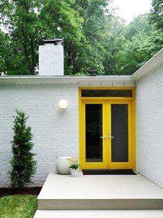 bright colored door on 50's ranch. Great patio/ walkway.