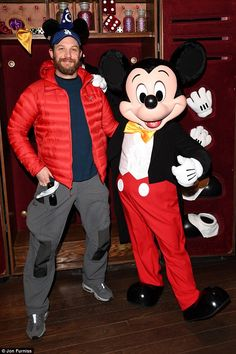Furry nice! Clad in a red puffer jacket, the Hollywood megastar looked uncharacteristically chirpy as he larked around with Mickey Mouse