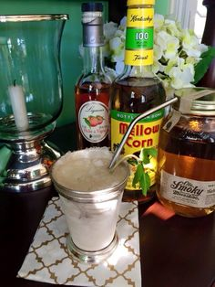 """Today's Featured Cocktail: The Rural Georgia Julep. Mellow Corn Kentucky whiskey, Ole Smokey peach moonshine, Combier Peche de Vigne, simple syrup, mint. After this round, to kill time until the Derby starts, I'm going to practice saying """"rural Georgia julep."""""""
