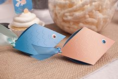These fish box favor boxes from Piggy Bank Parties are insanely cute!