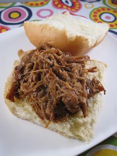 Pulled Pork is always good for a crowd and a few meals.  This looks like a good recipe.