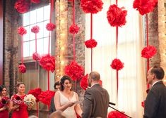 Dramatic (and simple DIY) tissue Pom garlands serve as a backdrop. Beautiful!