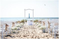 Elberta Life Saving Station Wedding Harbor Lights Resort | Rayan Anastor Photography | Frankfort MI Wedding Florals and decoration by Simply Exquisite by the Bay