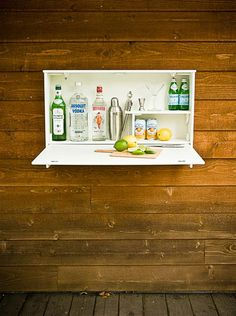 Wall-mounted bar - use an old kitchen cabinet, add chains and horizontal shelves, and make it DIY