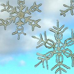 Make your own snowflake window clings using a hot glue gun - can be stored and re-used each winter!