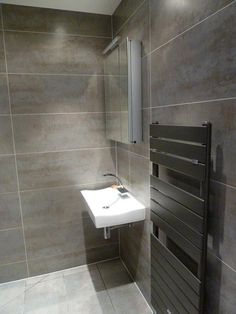 This was a tiny En-Suite Shower Room that was converted into a complete Wet Room. Description from munrosinteriors.com. I searched for this on bing.com/images