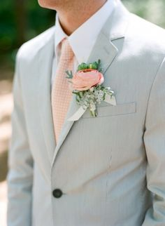 Peach tie and boutonniere