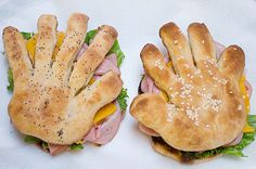 Using ordinary frozen dinner rolls, and making sure to stack a right and a left hand together — the sandwich will look like it's clapping together some lunch meats. And kids can use their own hands to make a turkey sandwich.