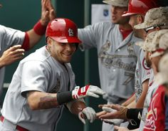 St. Louis Cardinals Yadier Molina is congratulated by teammates after his two-run home run in the first inning of a baseball game against the Kansas City Royals at Kauffman Stadium in Kansas City, Mo., Monday, May 27, 2013. (AP Photo/Orlin Wagner)