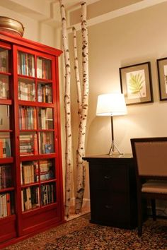 I know the focus is the birch trees, but I love the red bookcases.