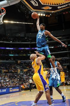 Corey Brewer dunking against Lakers.  It does not look like a real photo.  It looks not real.