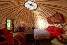 A yurt living area with small detached kitchen area at Chiltern Yurt Retreat near Aylesbury, England.