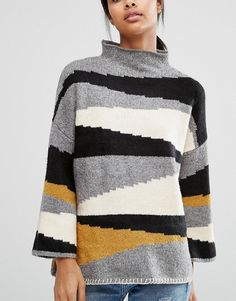 Getting dressed on chilly mornings just got 10 times easier with the Vila Colour Block High Neck Jumper in your closet.