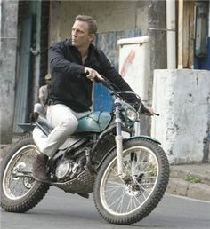 bond on a motorcycle - doubly cool