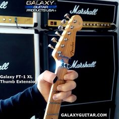 Galaxy FT-1 XL Custom Made Thumb Extension, Helping a Customer who lost his thumb over 20 years ago & no longer could play his Mandolin, Guitar & Up-right Bass. Problem Solved. Extra Large 1 inch interior width to fit his remaining Thumb portion. Another injured Musician able to play his instruments & make music again.   #fingerextensions #Prostheticsforguitarplaying #guitarfingerprotectors Guitar Fingers, Guitar Rack, Unique Guitars, Racking System, Guitar Accessories, Could Play, Mandolin, 20 Years, Bass