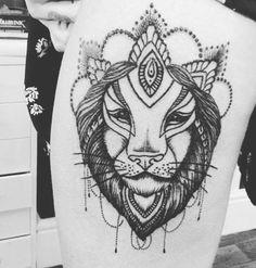 Girly lion thigh tattoo