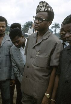 """President Mobutu, Mont Ngaliema, Kinshasa, Congo. Photo Eliot Elisofon ca 1967. """"In Zaire (now Democratic Republic of Congo), President Mobutu regularly appeared in public wearing a leopard-skin cap as part of his presidential regalia. While the form of the hat derives from a military cap, his choice of leopard skin was certainly calculated to exploit the symbolic association of the leopard with chiefly legitimacy and power that has a long history in many societies in this region."""""""