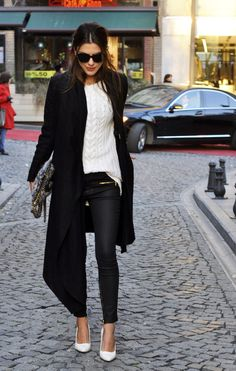 Black asymmetrical wool coat, black skinny pants, ivory cable knit sweater, white pointed toe heels. Love this look.