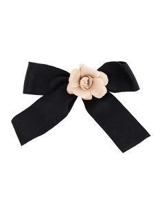grosgrain bow, satin camellia  Black and beige satin Chanel camellia and bow brooch with pinback closure.