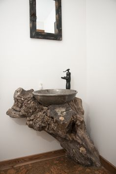 Tree trunk sink base creates a one-of-a-kind bathroom. www.shewsdesign.com