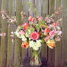 April Earth Day arrangement with crabapple branches, viburnum foliage, gerbera daisies, narcissus, parrot tulips, french tulips, and ranunculus! We love you Earth!