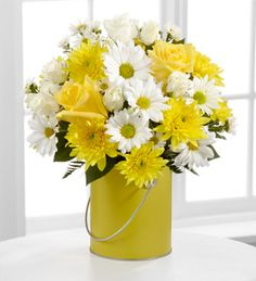 The FTD® Color Your Day With Sunshine™ Bouquet  http://www.thesunflowerflorist.net/product/the-ftd-color-your-day-with-sunshine-bouquet/display
