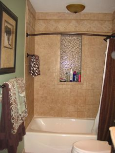 tiled tub surround with recessed niche. I want to do this in my master shower!