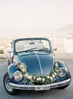 Santorini Wedding | Olive Bouquet | Reem Acra Wedding Dress | Antique Greek Car Rental | Navy Blue Suits | Light Blue Bridesmaids Dresses | Greece Wedding | JenHuangPhoto.com