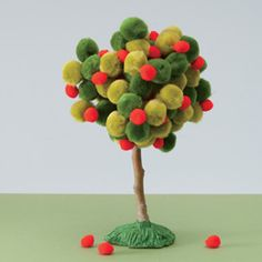 Celebrate the fall harvest by creating a miniature apple tree -- or a whole orchard! -- from pom-poms. For a fruitless autumnal tree, use orange, red, green, and brown pom-poms. -by Rhonda Rowley, Photograph by Ed Judice From FamilyFun Magazine